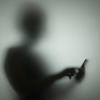 blury and out of focus photo of a person about to answer their cell phone