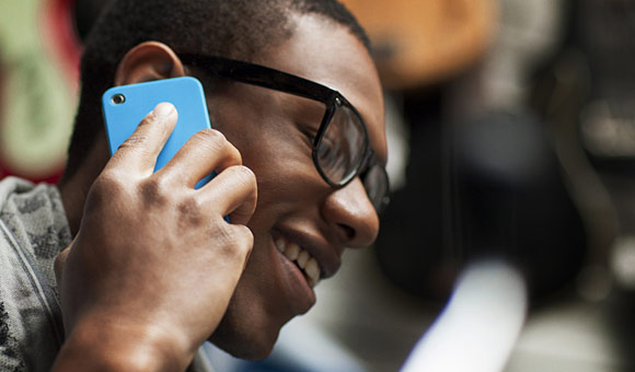 african american male holding phone to ear and smiling photo