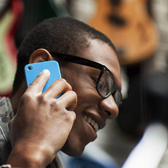 african american holding cell phone to ear and smiling photo