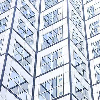 closeup of glass office building forming chevron pattern with grid windows photo