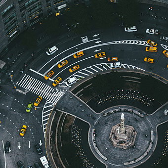 overhead view of taxis circling a traffic ring photo