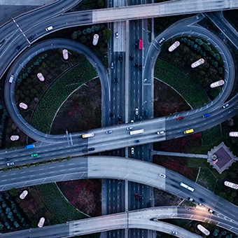 overhead view of highways looping in circles with traffic flowing photo