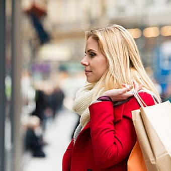 woman window shopping during holidays