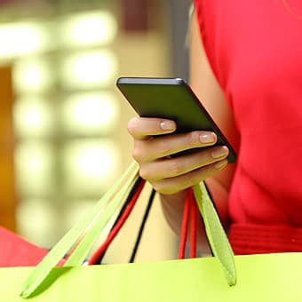 woman shopping with smartphone
