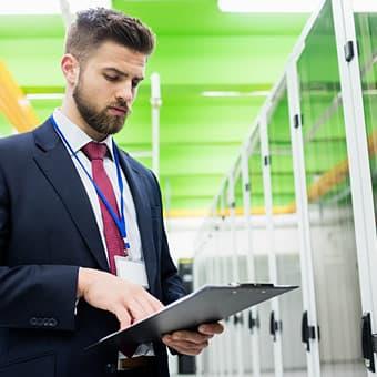 technician using checklist in server room