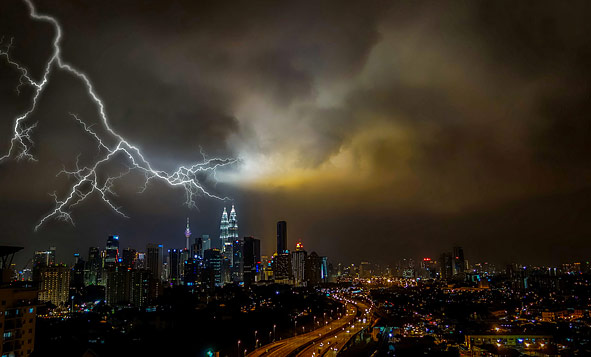 ominous thunderstorm over a city at night