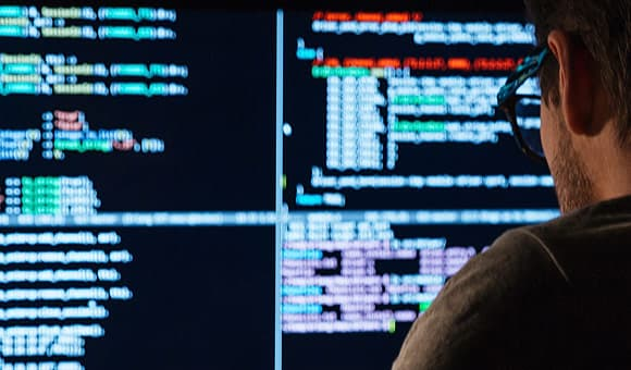 photo of hacker coding ransomware