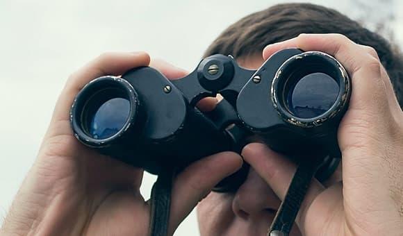 hunter with binoculars photo