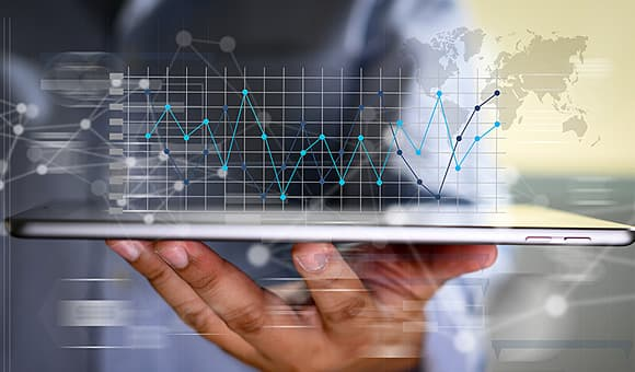 business person viewing spendchec results on tablet