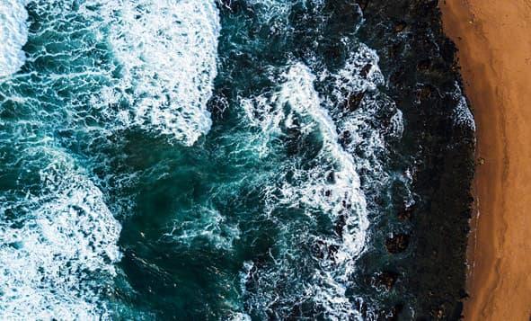 rough seas crashing on shore